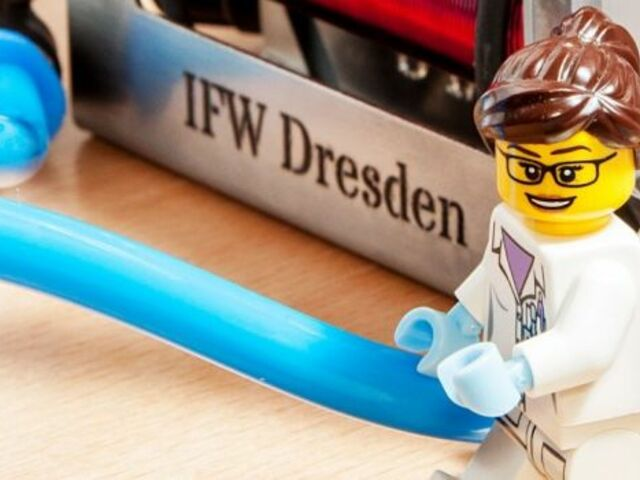 The picture shows a sign with the inscription IFW Dresden and a Lego minifigure.